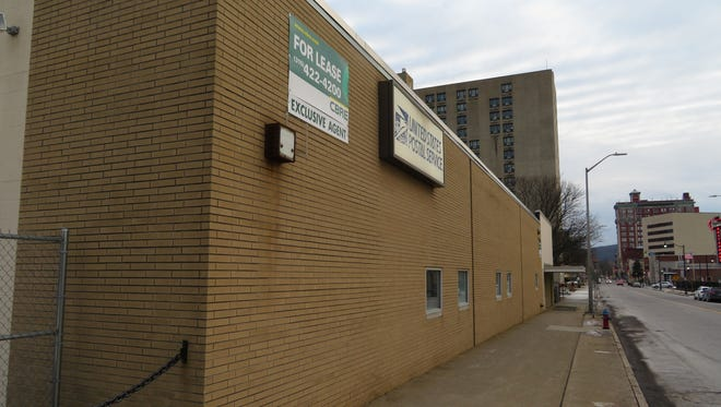 A former postal service storage facility in downtown Binghamton is being considered as the new site for the Binghamton University library archive.