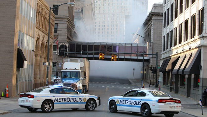 Two Metropolis police cars are on Shelby looking north to the Westin Hotel. Filming for the superhero movie Batman V. Superman: Dawn of Justice took place in downtown Detroit on Saturday, Aug. 9, 2014.