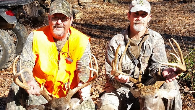 Next-door neighbors Kenny McGill (left) and Chad Wardlaw, of Madison, bagged these two bucks back-to-back while hunting less than a mile apart on public land.