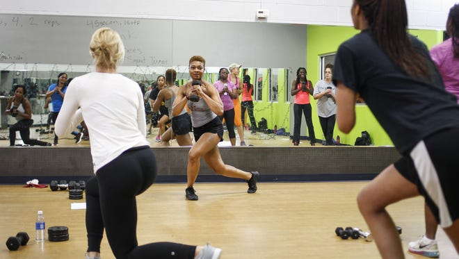 46-year-old bodybuilder Kimberly Whitfield of Lansing teaches a fitness class Feb. 17, 2015, at Genesis Fitness Center in Lansing.  Whitfield began bodybuilding at 42, as a way to stay fit, and to cope with life challenges.