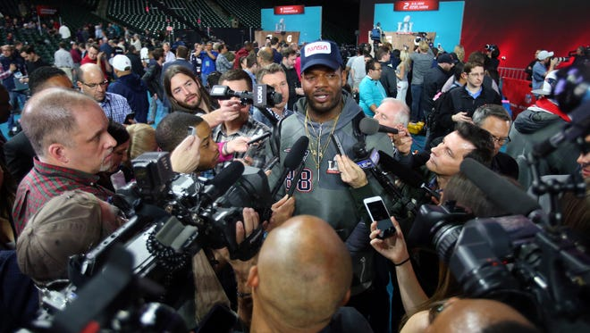 Patriots tight end Martellus Bennett is interviewed during Super Bowl LI Opening Night at Minute Maid Park Monday.