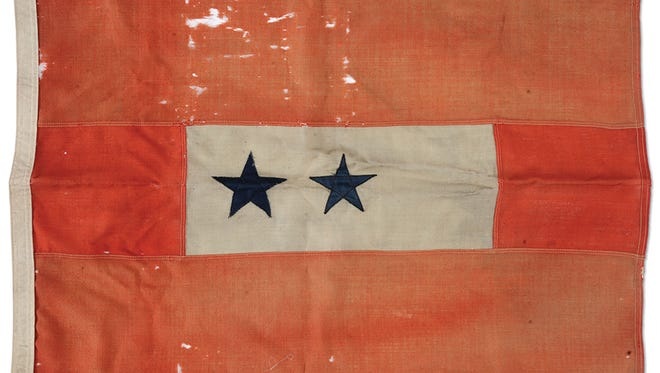 This Blue Star Mother's 23- by 35-inch flag was offered for sale in a recent auction for $1,000 to $2,000, but didn't sell. Many do not know it has been a tribute to those in the Armed Services since 1917.