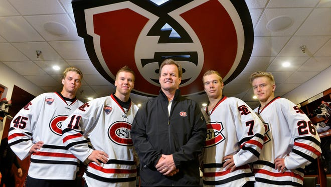 St. Cloud State University Assistant Coach Mike Gibbons (center) helped attract Finnish players from left: goalie Rasmus Reijola, forward Kalle Kossila, and defensemen Niklas Nevalainen and Mika Ilvonen.