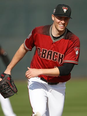 Diamondbacks Patrick Corbin (46) laughs with teammates during a field exercise during Spring Training at Salt River Fields at Talking Stick on February 17, 2018.