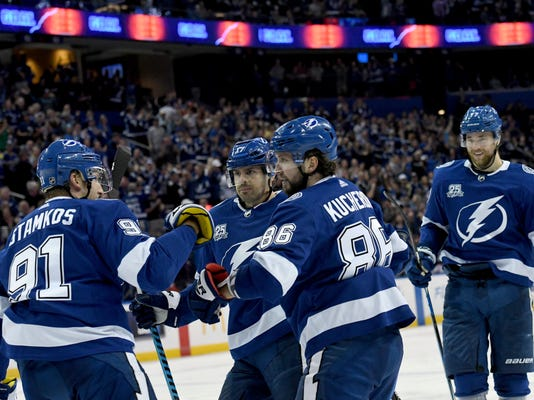 Tampa Bay Lightning center Steven Stamkos (91), left wing Alex Killorn (17), right wing Nikita Kucherov (86) and defenseman Victor Hedman (77) celebrate Kucherov's power play goal during the second period of an NHL hockey game against the Edmonton Oilers Sunday, March 18, 2018, in Tampa, Fla. (AP Photo/Jason Behnken)