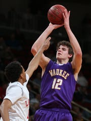Michael Jacobson of Waukee puts up a shot in the lane during a quarterfinal game between Waukee and North Scott on Wednesday, March 11, 2015, at the Iowa High School basketball championships at Wells Fargo Arena in Des Moines, Iowa.