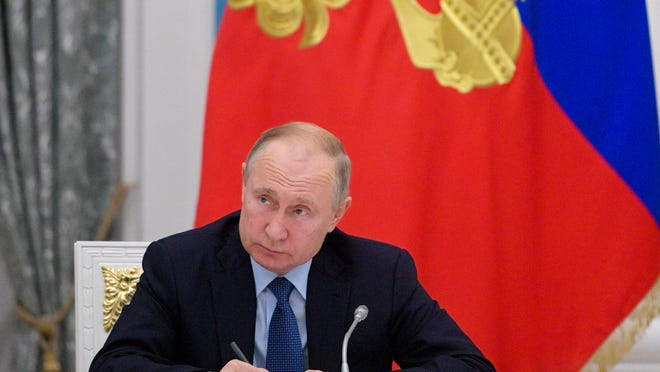 Russian President Vladimir Putin chairs a meeting in the Kremlin in Moscow in 2019.