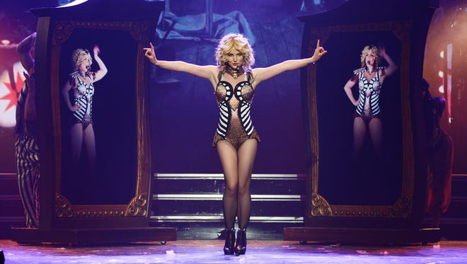 In this photo provided by Caesars Entertainment, Britney Spears rehearses 'Britney: Piece of Me' at Planet Hollywood Resort & Casino on Dec. 26, 2013, in Las Vegas. Spears began her two-year Las Vegas casino residency on Dec. 27.