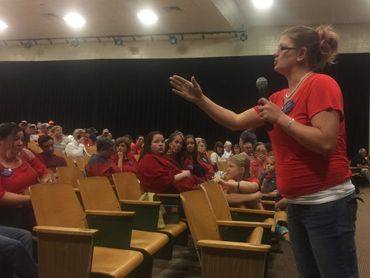 Kara Clayton, of Pickens County, speaks at a town hall