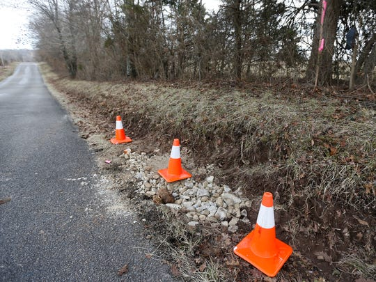 A sinkhole along Terrill Creek Road in Christian County has been filled after a runner spotted it on Sunday, Feb. 25, 2018.