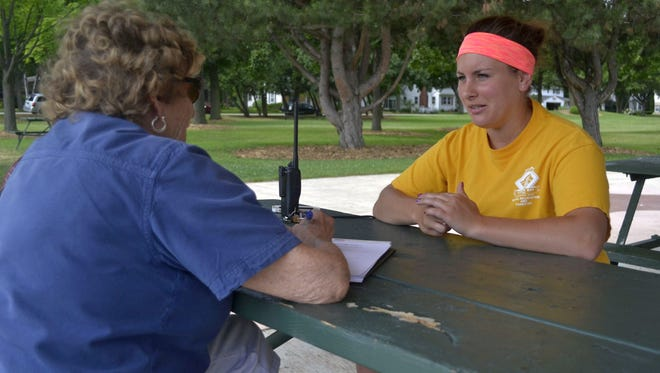 """Bay Area Community Council member Helen Schwartz, left, records responses as she interviews Bailey Hearley at Fisk Park in Green Bay this summer as part of the council's """"Connecting Our Community From Many Directions"""" project. Hearley, a Green Bay native, is a middle and high school teacher and works in the summer for the Green Bay Parks, Recreation & Forestry Department."""