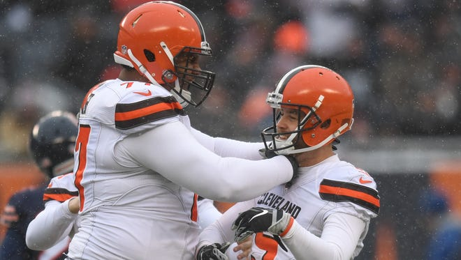 In this Dec 24, 2017, file photo, Cleveland Browns offensive lineman Zach Banner celebrates with kicker Zane Gonzalez after a field goal against the Chicago Bears during a game at Soldier Field. The Bears won 20-3.
