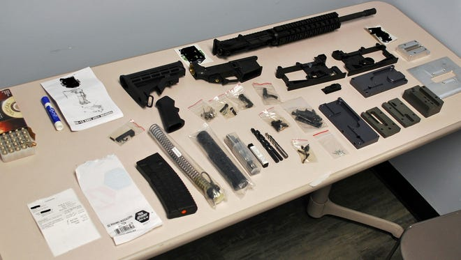 This photo provided by Galloway Township Police Department show parts and tools needed to assemble a functional AR-15 rifle. Police say a boy in New Jersey who was on probation for possession of a handgun on school property obtained parts to assemble a semi-automatic rifle. Galloway Township police arrested the 16-year-old on Wednesday, April 12, 2017. His name has not been released because he's a juvenile.