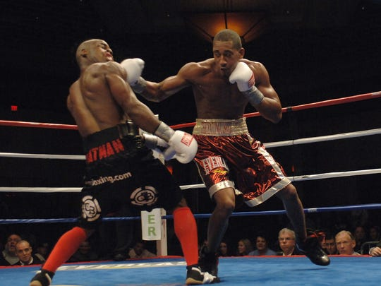 Demetrius Andrade, right, battles Chris Chatman in 2009.