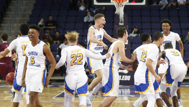 Shadow Mountain celebrates defeating Salpointe in the 4A Boys state championship basketball game at Grand Canyon University in Phoenix on February 24, 2018.