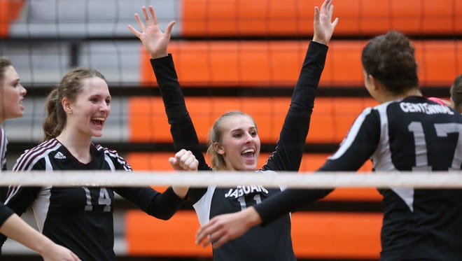 Ankeny Centennial players Anna Svoboda (11) and McKenna Pierson (14) celebrate with teammates during a Central Iowa Conference tournament semifinal against Johnston Thursday at Ames.