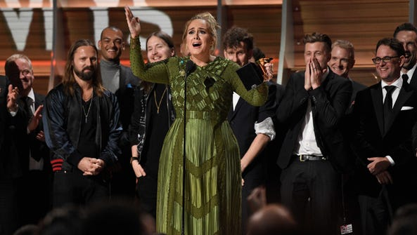 Adele cannot hold back her emotion as she receives