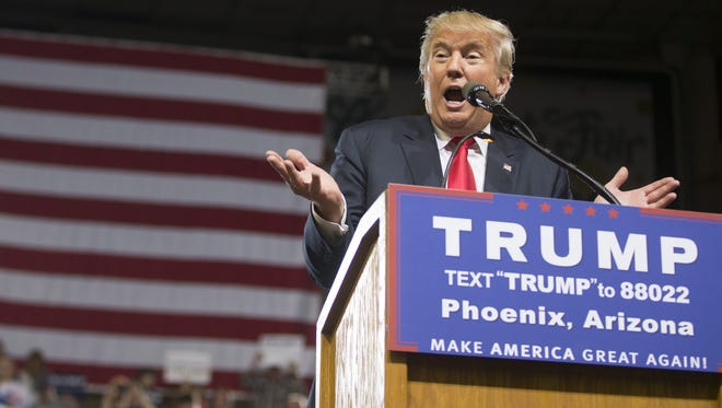 Republican presidential nominee Donald Trump, seen here speaking in Phoenix in June, says he will visit Arizona on August 31.
