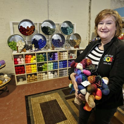 Pam Smith, owner of The Lost Sheep Yarn Shop, holds