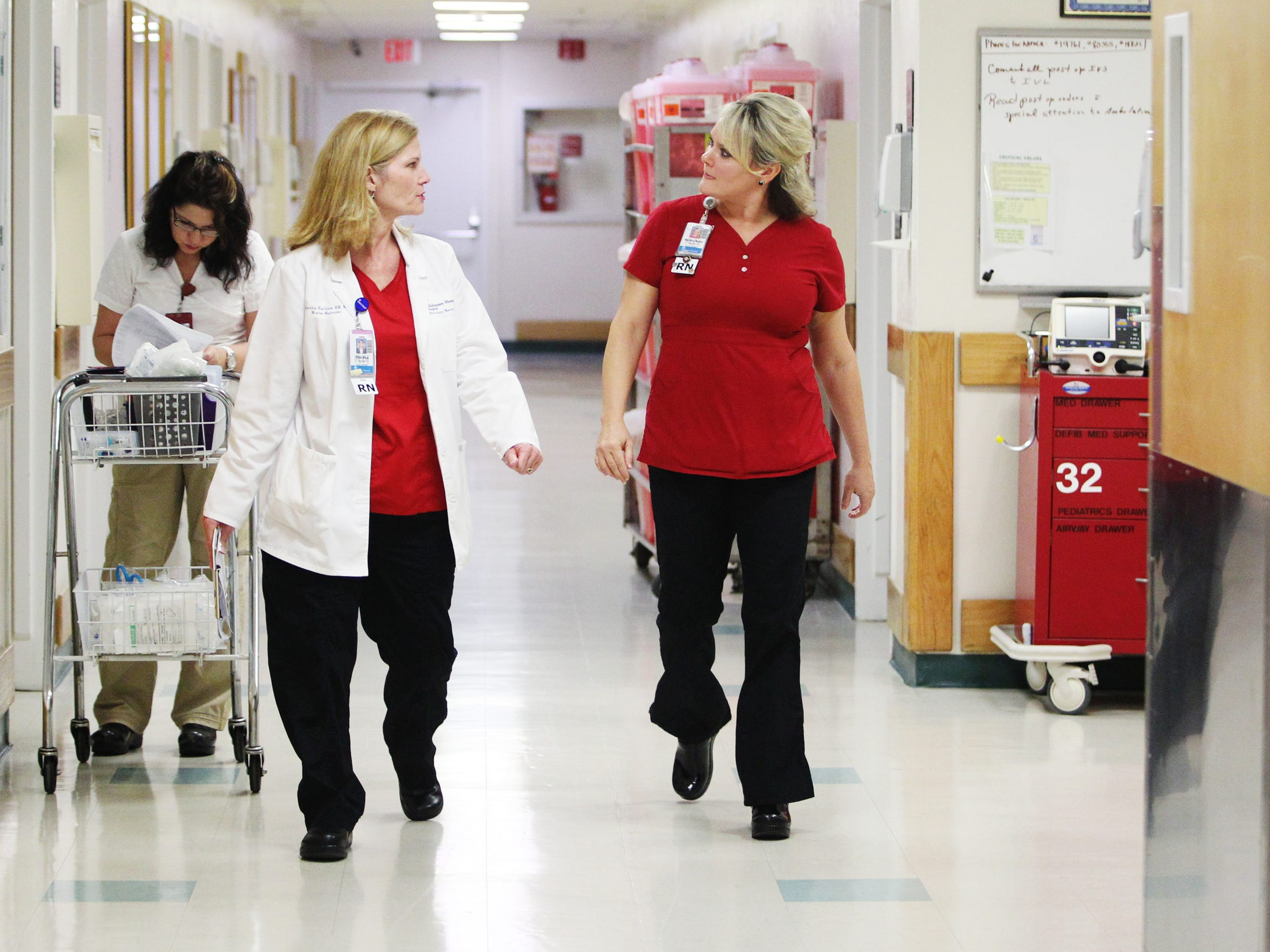 Tallahassee Memorial Hospital nurse managers Nancy Anne Teems, left, and Marsha Hardline talk . Nationally, nursing is a high-demand profession wrought with vacancies.