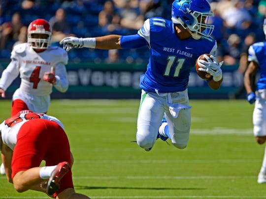UWF receiver Ishmel Morrow, shown last week jumping over a West Alabama defender, will need a big game along his offensive teammates when facing No. 7 North Alabama on Saturday in Florence, Ala.
