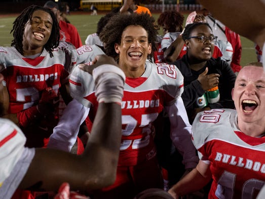 Bosse's JaVeon Edwards (34), Christian Bell (23) and
