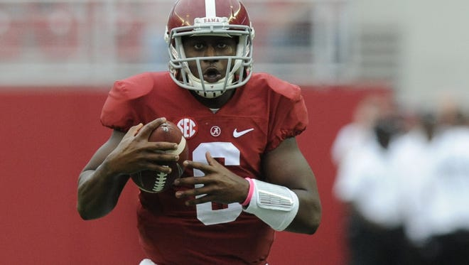 PHOTOS BY MICKEY WELSH/ADVERTISER Alabama quarterback Blake Sims threw for two touchdowns and ran for another against Southern Miss. Alabama quarterback Blake Sims (6) scrambles for yardage against Southern Miss at Bryant Denny Stadium in Tuscaloosa, Ala. on Saturday September 13,  2014.