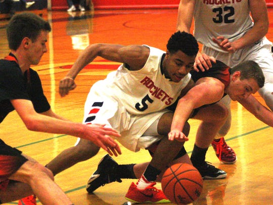 Players go all out for a loose ball during Friday night's