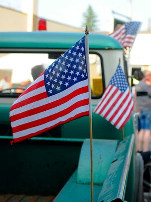 American flags decorate the streets in Holdingford as part of Holdingford Daze car show in 2015.