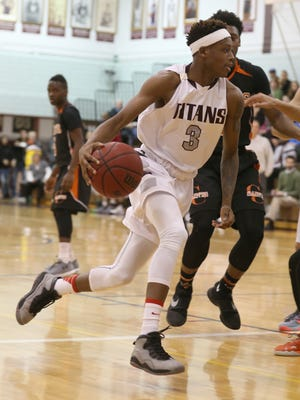 Arcadia's Keith McGee drives hard to the basket during a game earlier this season.