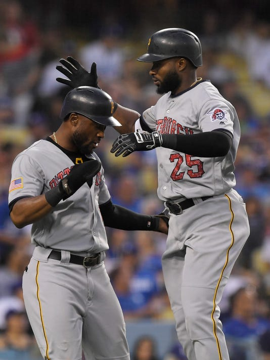 Hill pitches Dodgers past Pirates 6-4 for 3-game sweep