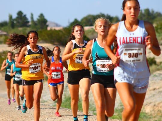 Alamogordo's Gabriella Sandoval, far left, along with teammate Madison Varnier run alongside the canal Friday.