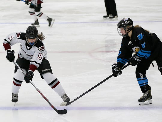 Central Wisconsin Storm's Eden Gruber(9), left, and Wisconsin Valley Union's Lyndsey Glodosky(10), battle for the puck during Thursday night's girls hockey game at Greenheck ice rink in Weston, Wisc. T'xer Zhon Kha/USA TODAY NETWORK-Wisconsin