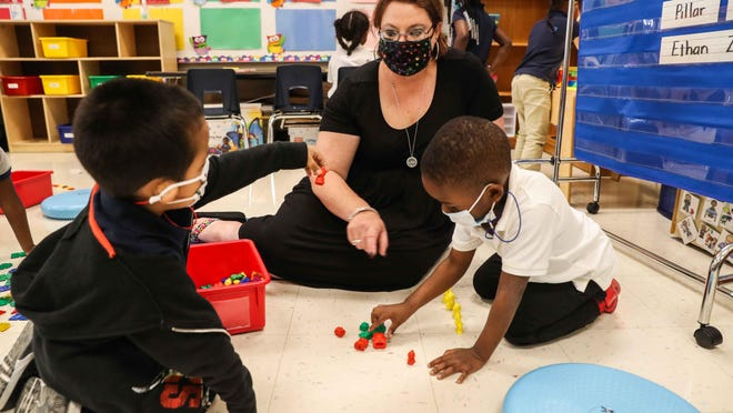 Prekindergarten teacher Amanda Bradley plays Thursday with Ethan Zuniga, left, and Billy Nix at Overton Elementary School. The Austin district has 5,600 fewer students, largely due to declines in prekindergarten and kindergarten enrollment.