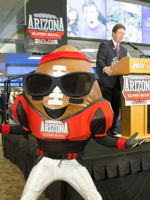 Phoenix Mayor Greg Stanton speaks while mascot Spike looks at the crowd during the unveiling of the countdown clock at Phoenix Sky Harbor Airport in September 2014.