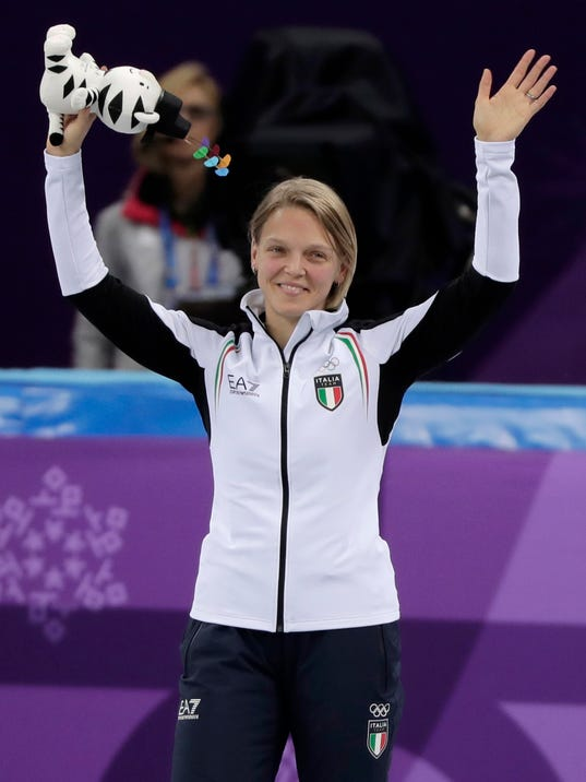 AriannaFontana of Italy celebrates on the podium during the venue ceremony after the ladies' 500 meters short track speedskating final in the Gangneung Ice Arena at the 2018 Winter Olympics in Gangneung, South Korea, Tuesday, Feb. 13, 2018. (AP Photo/Julie Jacobson)