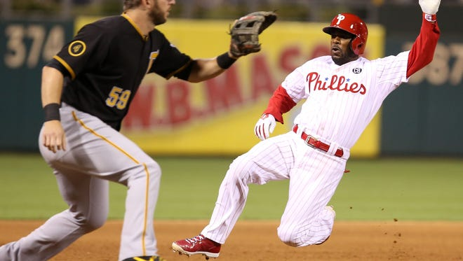 Philadelphia Phillies shortstop Jimmy Rollins (11) slides safe into third base after hitting a triple during the fourth inning Monday against the Pittsburgh Pirates at Citizens Bank Park. Credit: Bill Streicher-USA TODAY Sports