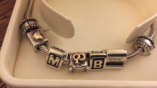 Mama's Pandora bracelet with the charms Pops decided