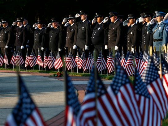 Morris County firefighters salute during the National