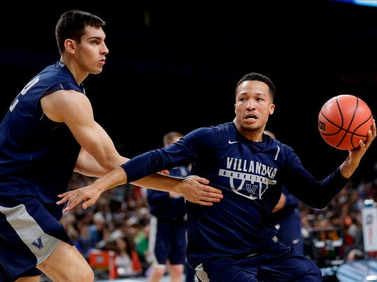 Villanova guard Jalen Brunson, right, drives past teammate Dylan Painter, left, during a practice session for the Final Four NCAA college basketball tournament, Friday, March 30, 2018, in San Antonio. (AP Photo/David J. Phillip)