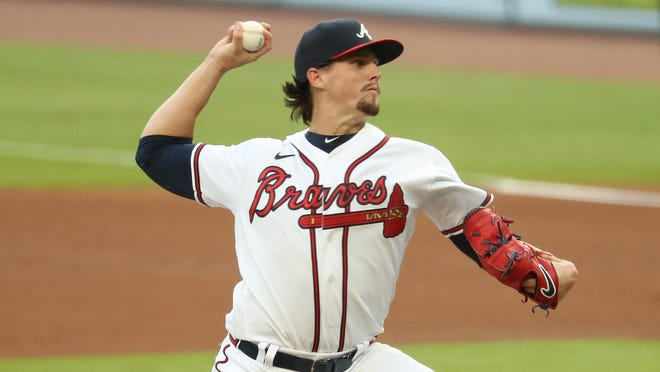 Sep 8, 2020; Atlanta, Georgia, USA; Atlanta Braves starting pitcher Kyle Wright (30) delivers a pitch to a Miami Marlins batter in the first inning at Truist Park. Mandatory Credit: Jason Getz-USA TODAY Sports