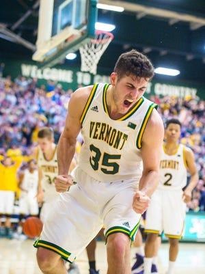 The University of Vermont's Payton Henson celebrates a score against the University of Albany in Burlington on Wednesday, February 22, 2017.