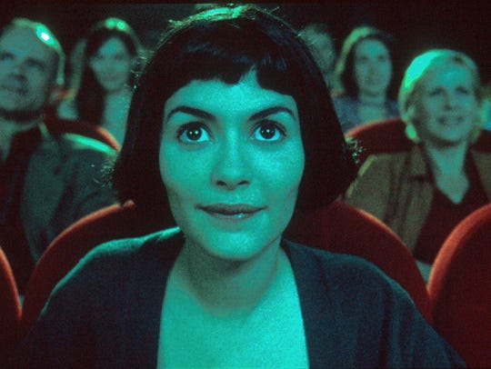 "French actress Audrey Tautou watches a movie in a scene from French director Jean-Pierre Jeunet's ""Amelie."""