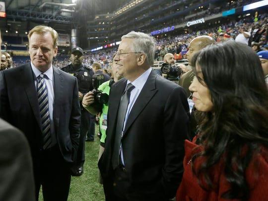NFL Commissioner Roger Goodell, left, meets with Buffalo Bills owners Terry and Kim Pegula before a game in Detroit on Nov.24, 2014.