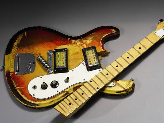 Kurt Cobain's guitar was played and smashed in a 1989 concert. The estimated sale price at auction June 24 is $30,000 to $40,000.
