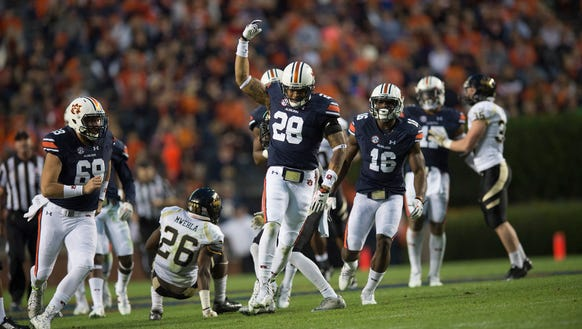 Auburn Tigers defensive back Tray Matthews (28) celebrates