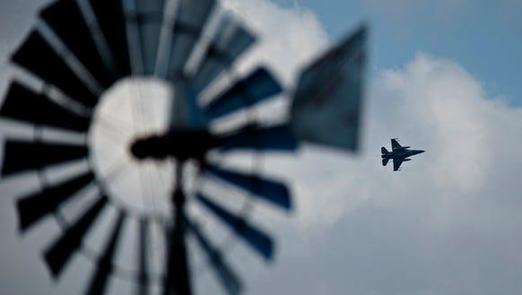 An F-16 fighter pilot flies over downtown Montgomery