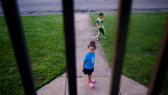 Jeremiah Markham, 5, and his sister, Neveah, 3, play