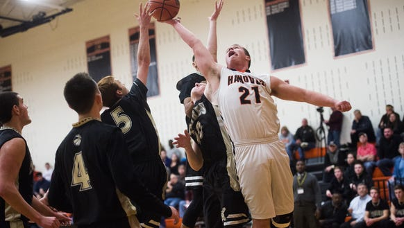 Hanover's Bryce Hart leaps for a rebound against Delone