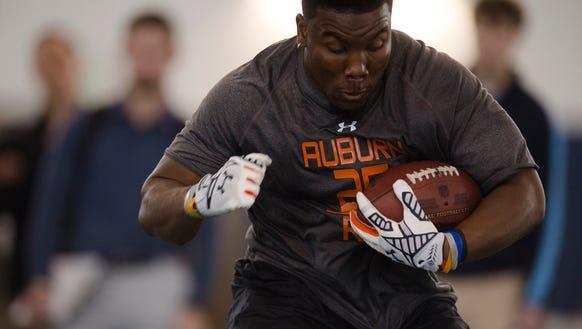 Auburn running back Peyton Barber runs a drill during